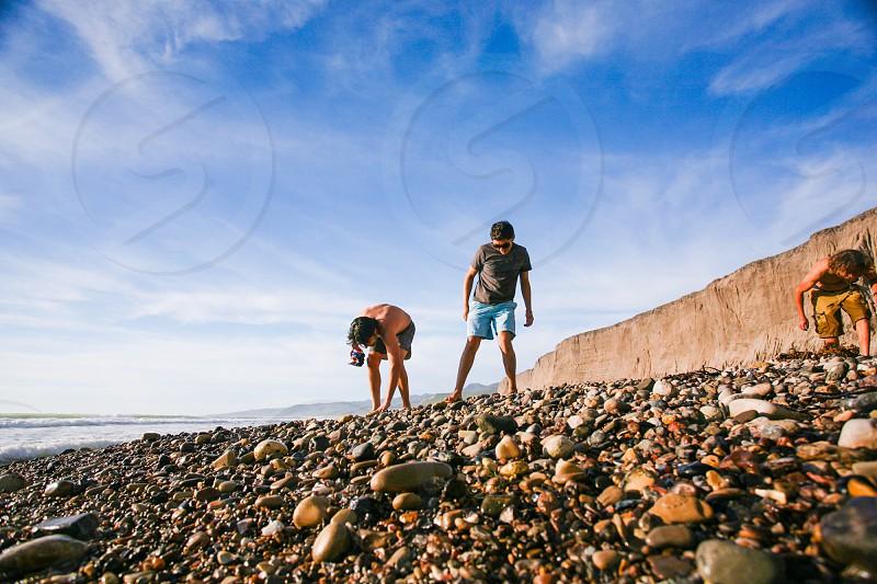 beach rocks searching photo