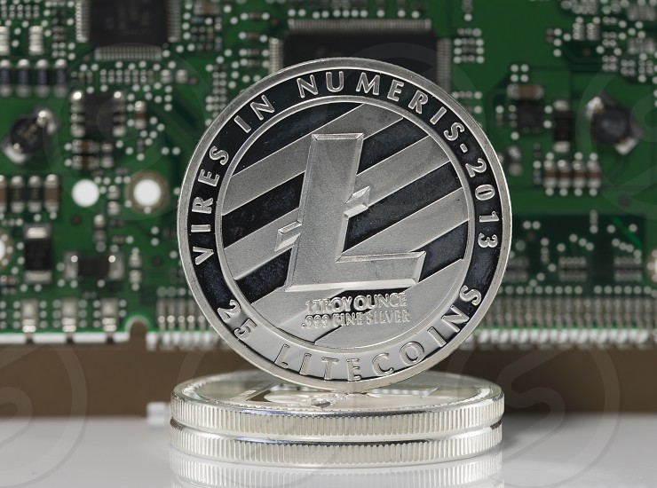 silver litecoin or ltc with computer print background photo