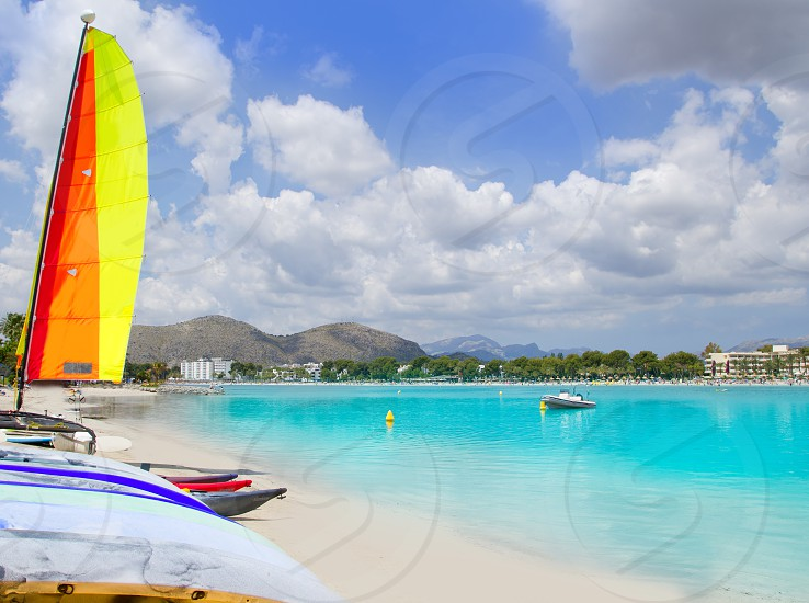 Beach of Puerto de Alcudia in Mallorca  with hobie cat and kayak on Balearic Islands Spain photo