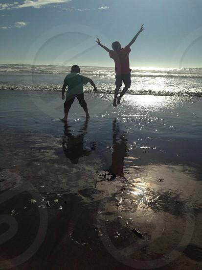 boys on seashore photo