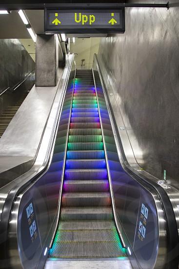 Escalator with beautiful multi-colored illumination in the metro photo