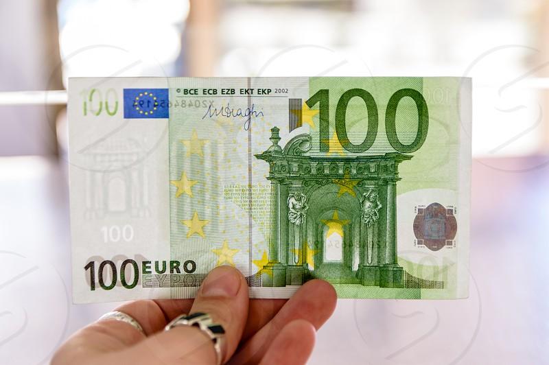 Euro paper money banknote of 100 denomination photo