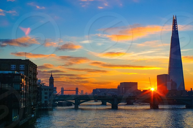 Sunrise over the river Thames with The Shard and Tower Bridge in view photo