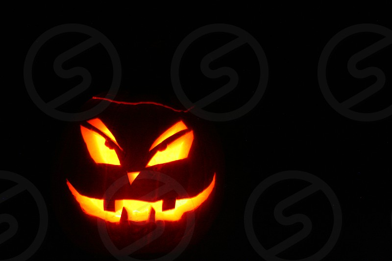 Candlelit Jack O Lantern at night photo