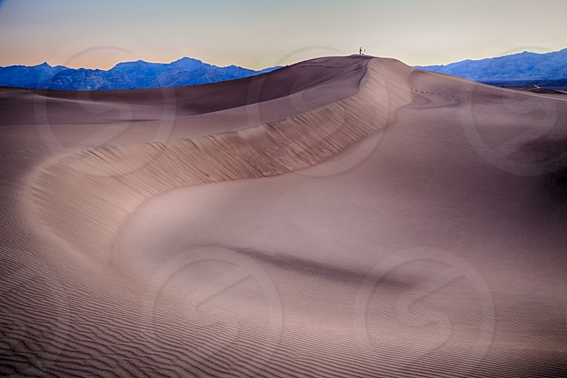 Photographer in Mesquite Dunes located inDeath Valley National Park photo
