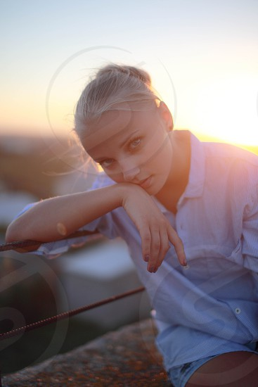 Pretty blonde girl sitting on the bench. photo