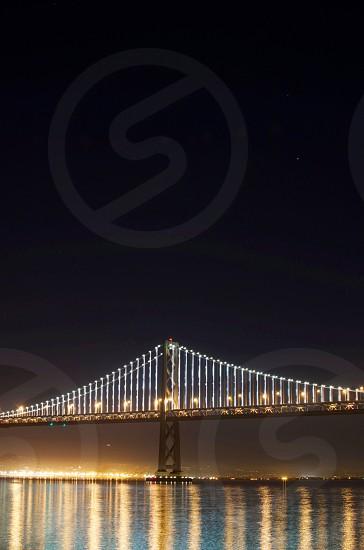 lighted metal bridge on water photo