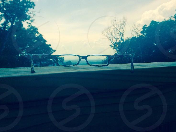 eyeglasses on wooden plank photo
