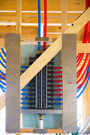 plumbing manifold system PEX tubing for house water distribution photo