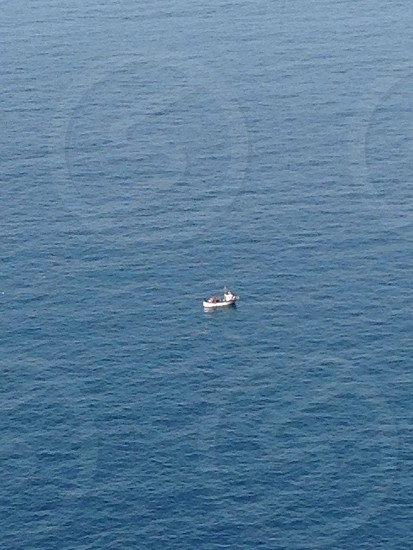 boat on middle of the sea photo