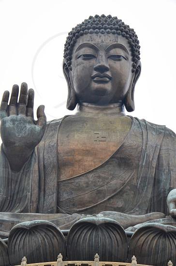 """Tian Tian Buddha also known as """"Big Buddha"""" is a large bronze statue of Buddha Shakyamuni completed in 1993. photo"""