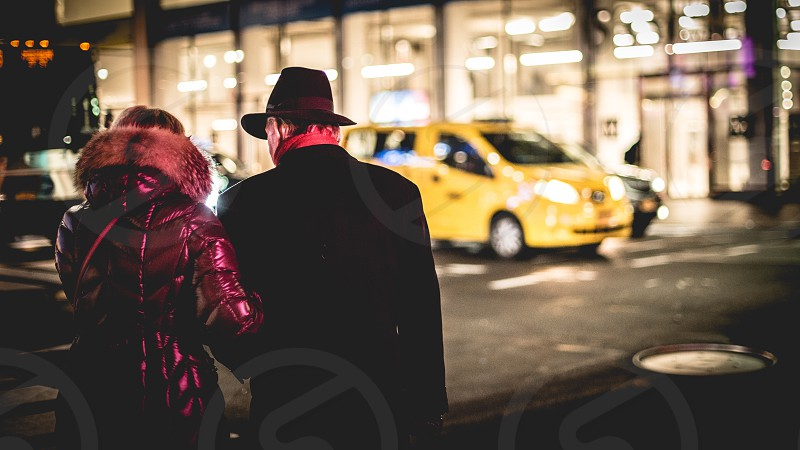 New Yorkers in the winter and yellow taxi as always  photo