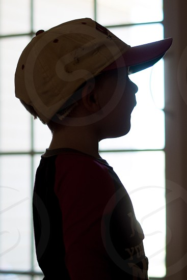 child in baseball cap photo