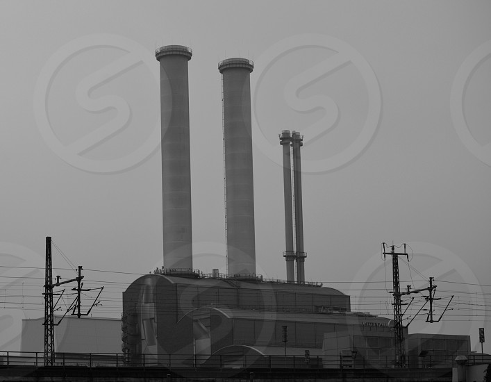 factory with white exhaust pipe photo