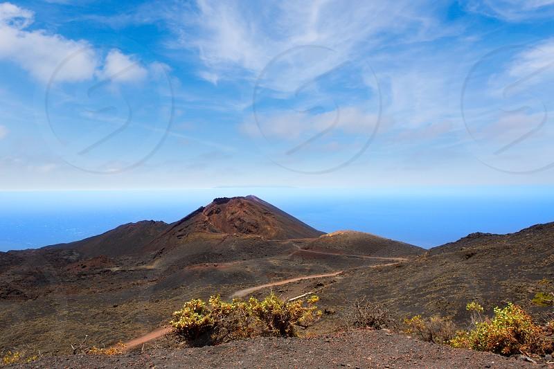 Teneguia volcano in La Palma Canary island with Atlantico ocean background photo
