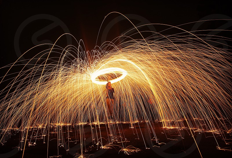 person playing fire display in time lapse photography photo