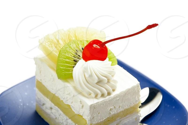 piece of fresh fruit cake on white background photo