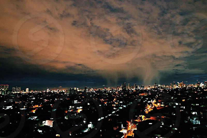 An almost rain cloud on the dry season of Jakarta's Night photo
