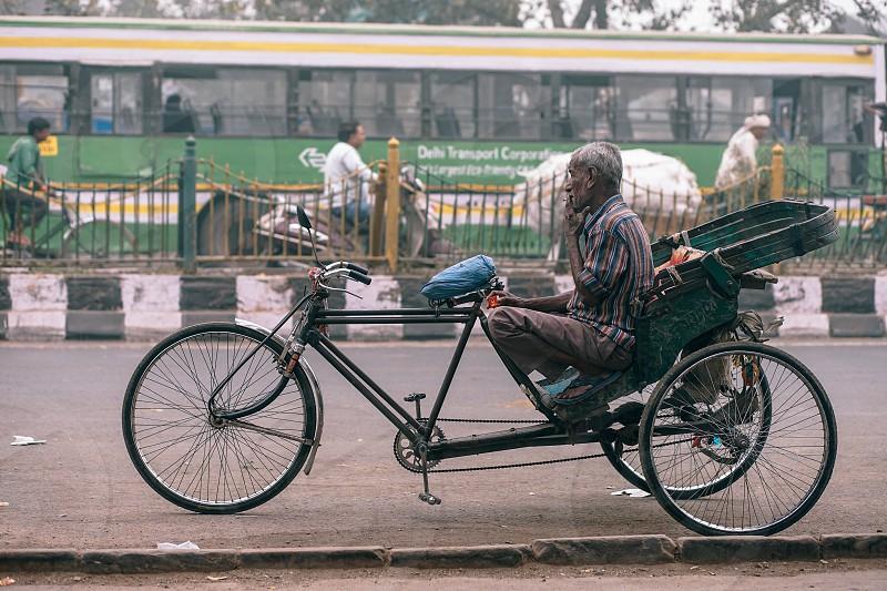 Rickshaw driver taking a smoke break photo