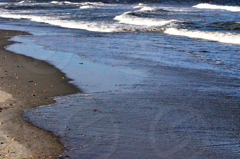Ocean waves on the sand - Myrtle Beach South Carolina - USA photo