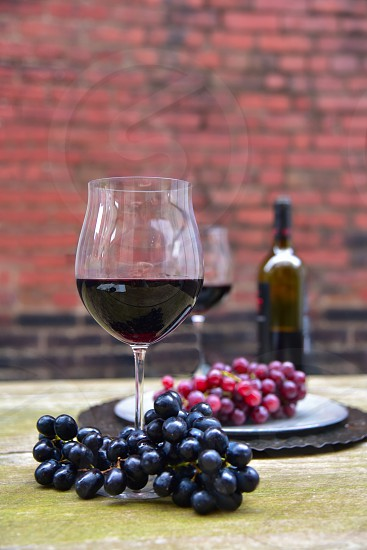 Wine glasses. Wine. Outdoor. Rustic table. photo