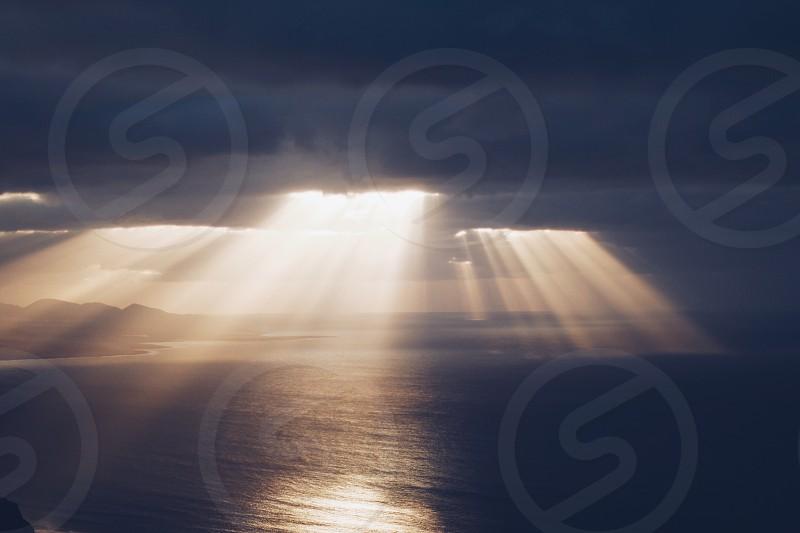 ray rays clouds seaside ocean Lanzarote storm photo
