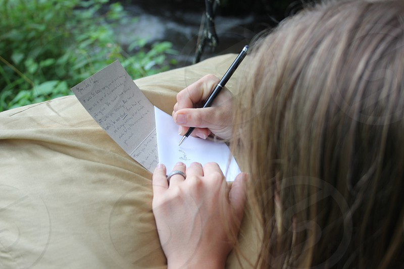 Writing wedding thank you notes by the creek  photo