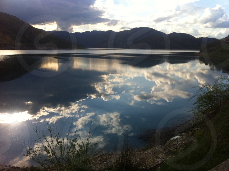Lake reflection water night mountains sky sea clouds nature natural environment ray light dark eco ecology rural country landscape scenic summer travel calm idillic horizon scene travel vacation coastline photo