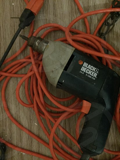 black and gray Black & Decker corded drill photo