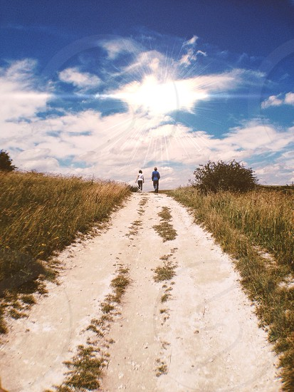 Pathway. Sun. Path. Couple. Silhouette.  photo