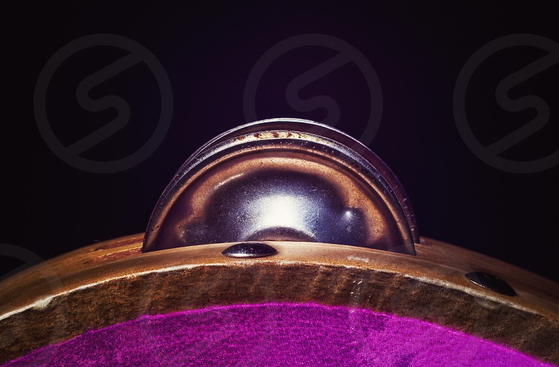 Details of a wooden tambourine colorful illumination accentuate shapes and material.  photo