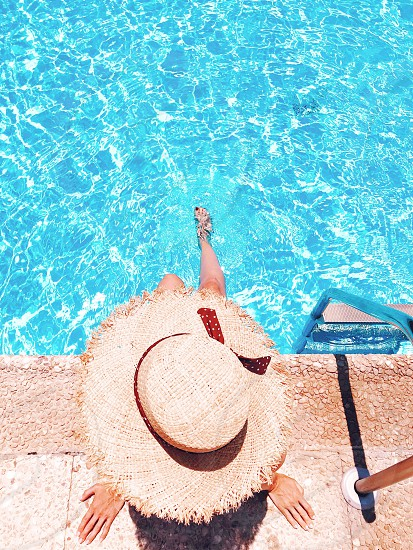 Chilling swimming swimming pool summer summertime summer lifestyle fashionista straw hat leisure relaxation relaxing moments poolside pool overhead view travel blue woman pool time aqua water looking down weekend outdoors overhead shot photo