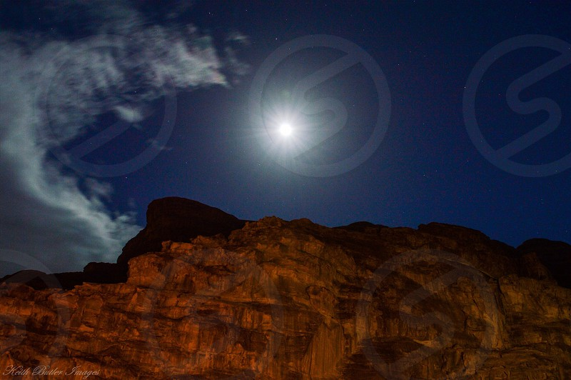 mountain under blue and white cloudy sky during night time photo