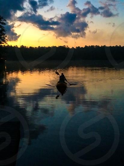 Kayaking at sunset photo