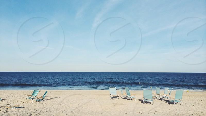 White chairs on beach photo