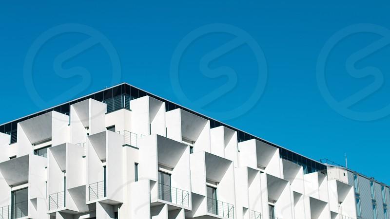 White modern multi storied building on blue sky background photo