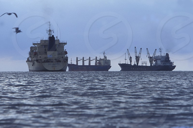 Transport ships on the coast of Tela in Honduras in Central America photo