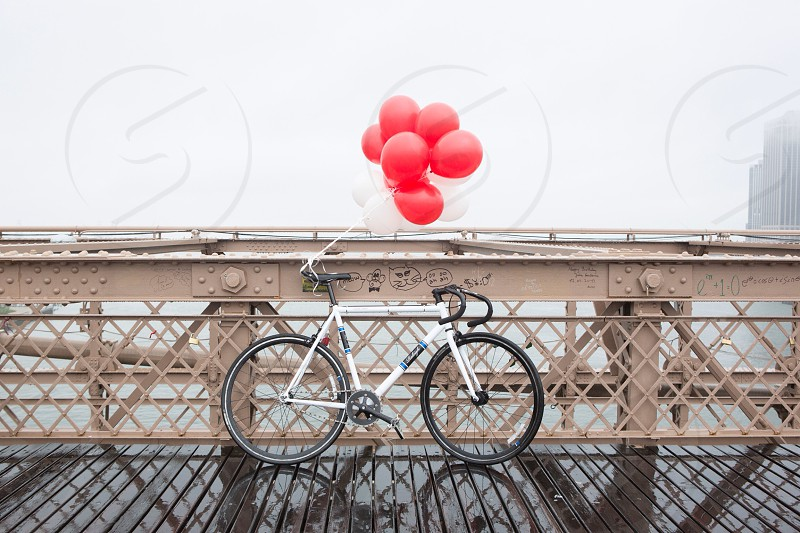 red and white balloons tied on the mountain bike photo