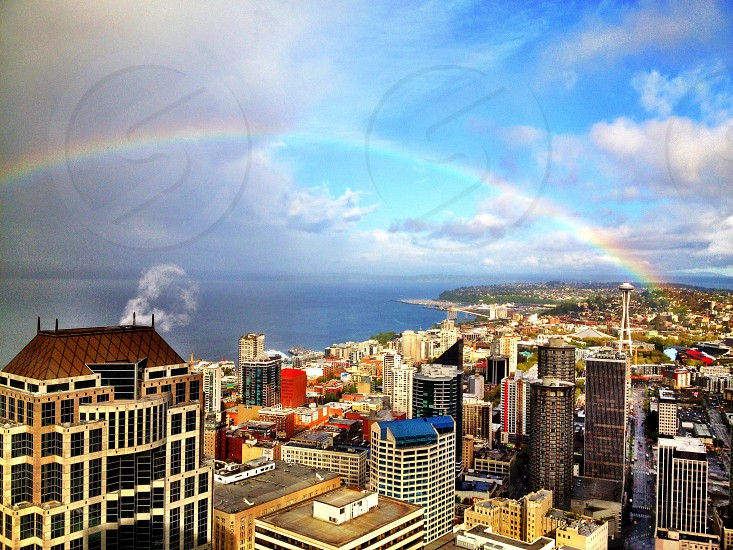 aerial view city buildings with rainbow photo