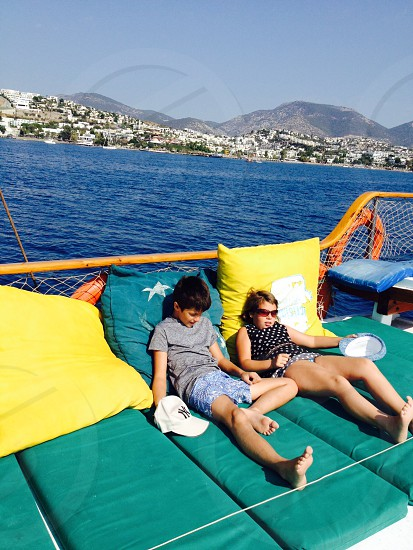 This is the life day trip on a boat Mediterranean sea sunbathing boat boat trip.  photo