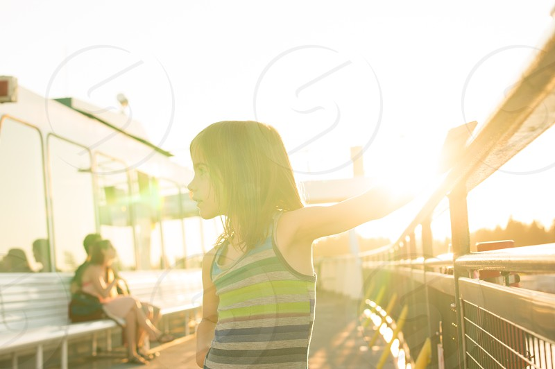 Little girl on a boat in the sunset.  photo