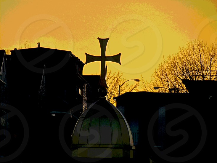 dome with cross on top on sunset view photo