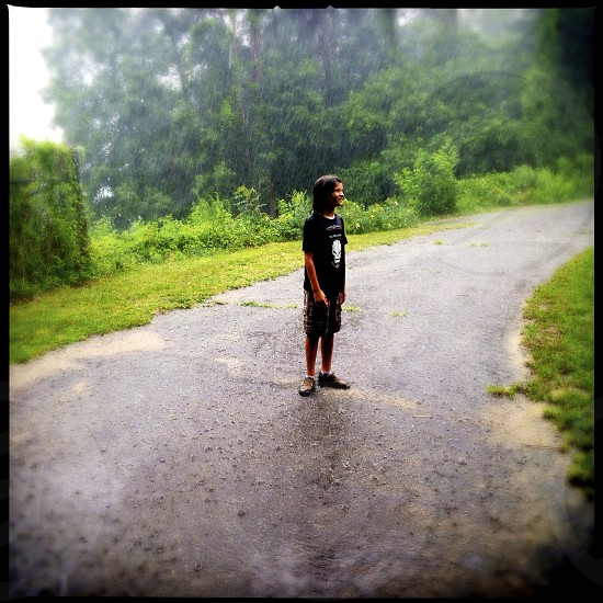 Boy in the rain photo