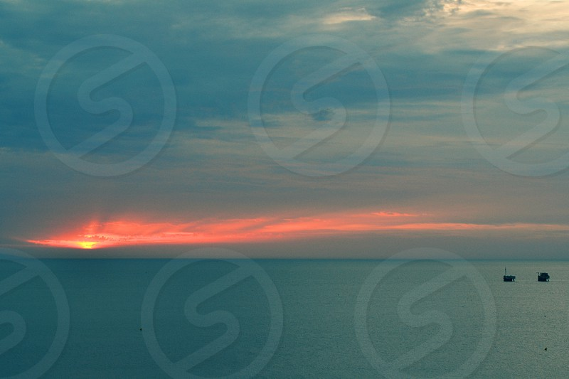 Sun coming up view from Malaga Spain photo