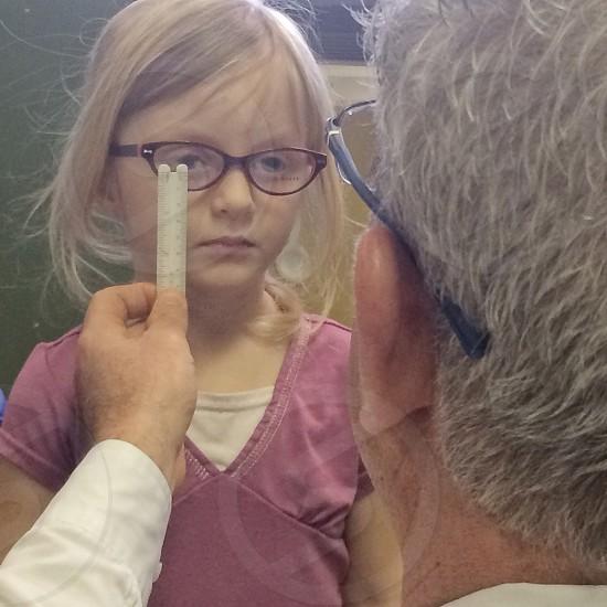 Healthcare glasses examine testing eyes girl child looking  photo