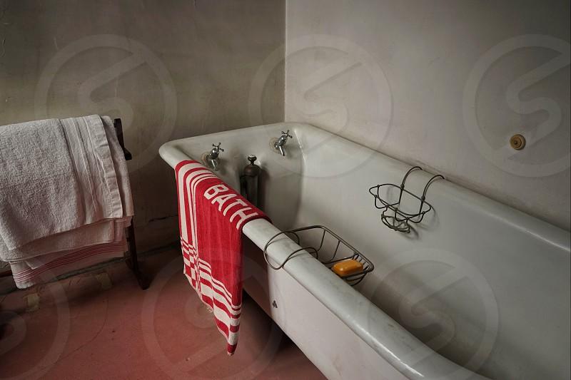 Old style bath and bathroom towel and bathmat photo