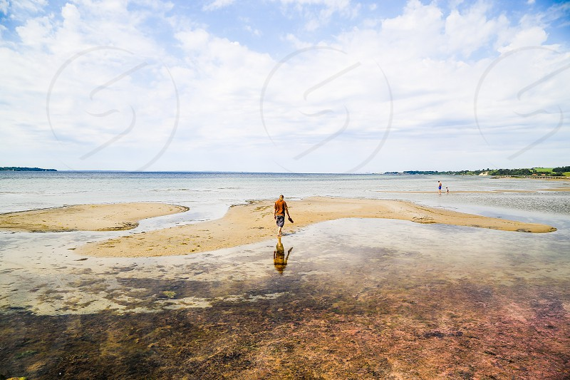 Water beach reflection man sand abandoned ocean empty deserted photo
