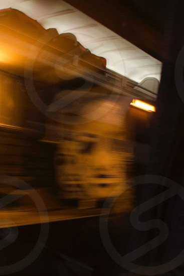 Graffitti of a haunted face in a New York tunnel taken from a train  photo