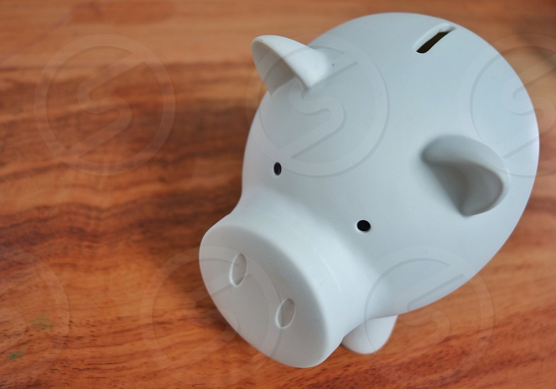 Piggy bank on table wood photo