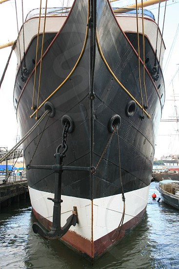 front of boat with black anchor photo